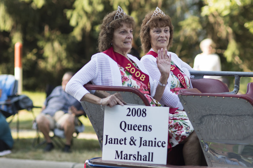 Former Festival Queens Janet and Janice Marshall make their way down the parade route during the Twins Days Festival in Twinsberg, Ohio on Saturday. Photo by Dustin Franz