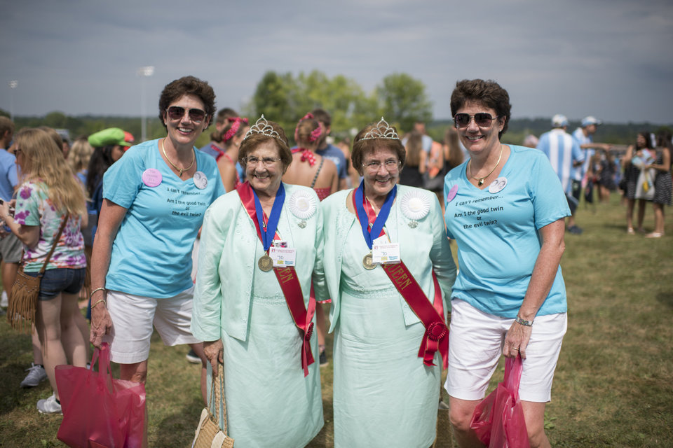 From left, Dorris Fejka, Charlotte and Rose Italiano and Donna Saxman pose for a portrait at the Twins Days Festival in Twinsburg, Ohio on August 8, 2015. Photo by Dustin Franz