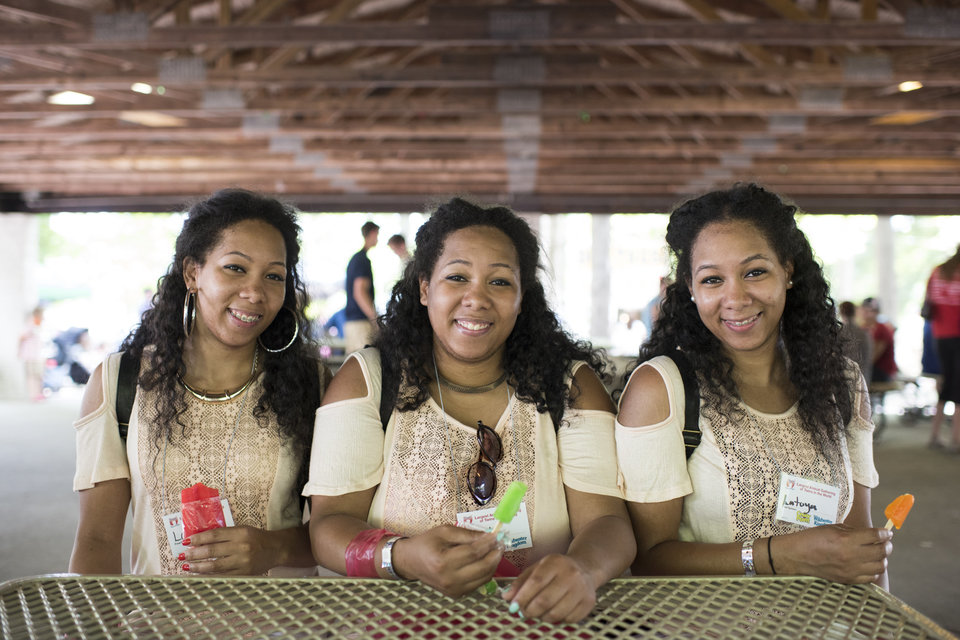 Identical triplets Latrina, Latasha and Latoya Thompson, 25 from Detroit Michigan, attend the Twins Days Festival for the first time. Photo by Dustin Franz