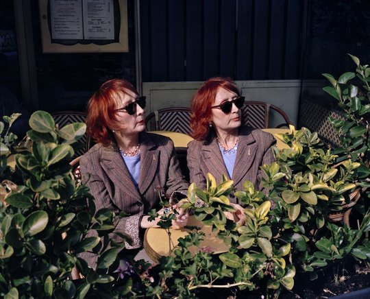 "'Mady and Monette, suntrap café', 2011, 40"" x 50""  ""Most people do not realize but everyone look the same on the streets today, everyone is dressed in the same way and they have the same hairstyles and they do not even notice it."""